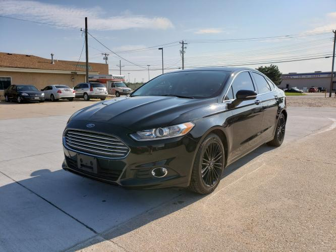 2016 Black /BLACK Ford Fusion SE (3FA6P0HD4GR) with an 1.5L L4 DOHC 16V engine, 6-Speed Automatic transmission, located at 625 South Lincoln Avenue, York, NE, 68467, (402) 362-5933, 40.859093, -97.592934 - Photo #0